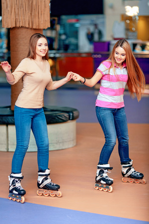 blading: Best friends ever. Two beautiful girls having fun on the roller rink playing and laughing to each other