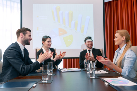 applaud: Successful presentation. Participants of the business meeting applaud each other delighted with the results of the meeting Stock Photo