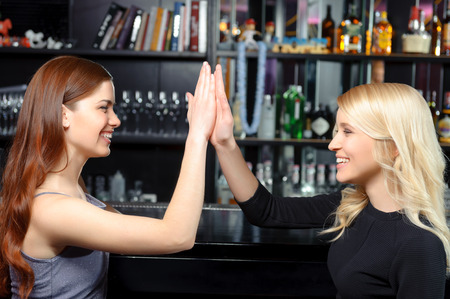 great job: Great job. Two beautiful smiling girls clapping their hands delighted and cheerful