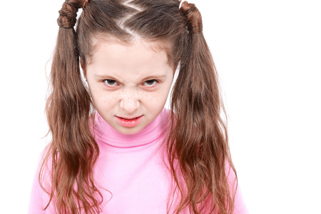 turtleneck: Portrait of a small girl looking very angry something wearing pink turtleneck isolated on white background Stock Photo