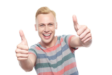 think about: Thumbs up. Handsome young smiling blond-haired man showing thumbs up on isolated white background