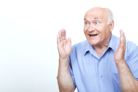 feeling up: Great surprise. Furious grandfather holding his hands up and feeling surprised isolated on white background.