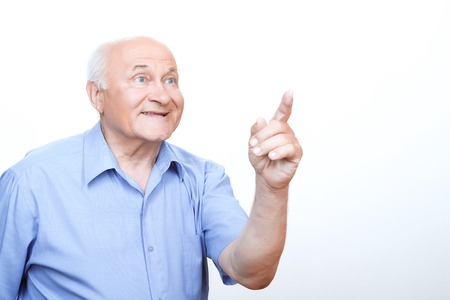 happy old man: Eureca. Inspired grandfather holding his hand up and pointing with index finger while feeling illuminated. Stock Photo
