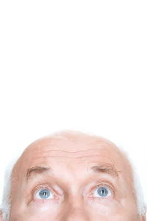 old man happy: Overwhelming admiration. Agreeable grandfather holding his head and looking up while standing isolated on white background