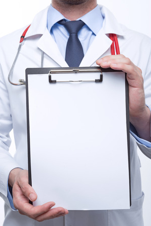 the cardiologist: Take it. Close up of sheet of paper with the cardiologist holding it on the background. Stock Photo