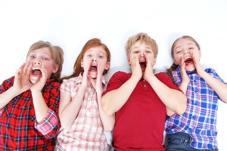 upbeat: Screaming out loud. Upbeat friends lying on the floor and screaming while looking at you. Stock Photo