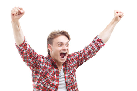laugher: We are the champions. Joyful guy keeping his hands up while rejoicing in victory Stock Photo