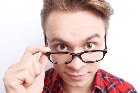 그것은 무엇입니까. 동의하는 젊은 남자 안경을 터치하고 똑바로보고. 스톡 콘텐츠