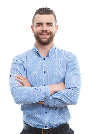 Pleasant smiling middle-aged man with beard standing with crossed arms on isolated white background.
