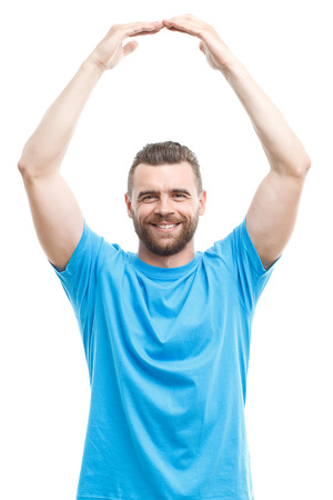 arms above head: Portrait of handsome smiling middle-aged man with beard holding arms above his head isolated on white background Stock Photo