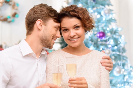 laugher: My sweet. Positive jubilant young couple drinking champagne and celebrating while bonding to each other Stock Photo