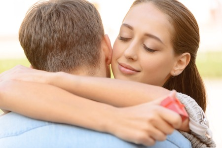 pleasant emotions: Tender love. Pleasant loving delighted couple expressing real emotions while embracing Stock Photo