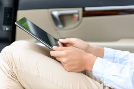 laugher: Wise devise. Close up of laptop in hands of young woman holding it and sitting in the car