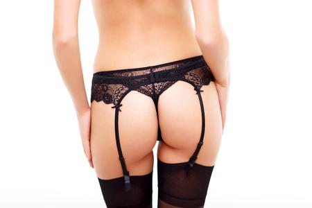 sexuel: Suivez-moi. Gros plan d'une jeune fille attirante sexuellement vous séduire en position debout tourné le dos isolé sur fond blanc Banque d'images
