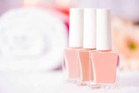 pink nail polish: Close up of little bottles with nail polish standing on the table of beauty salon