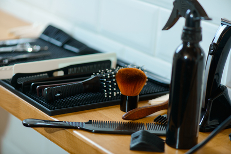 clippers comb: Ready to work. Devices for making haircut lying on the table Stock Photo