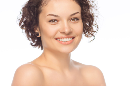 look pleased: Smiling face. Young attractive lady looks happy. Stock Photo