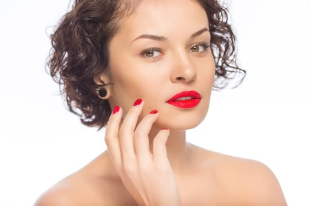 appealing: Pretty woman. Young appealing lady looks serious while posing on camera. Stock Photo