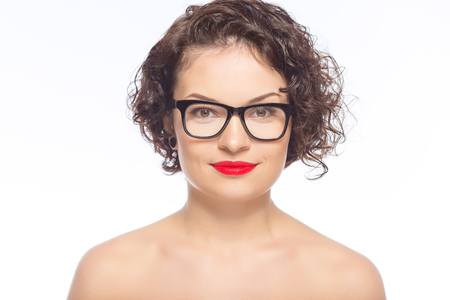 appealing: Looking smart. Young appealing woman posing with transparent glasses. Stock Photo