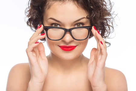 appealing: Woman in glasses. Young appealing woman posing with transparent glasses.