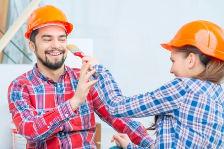 upbeat: Pleasant upbeat couple going to make renovation while playing with brush