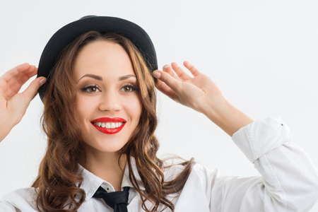 appealing: Girl and hat. Young appealing girl is smiling while trying on a hat. Stock Photo