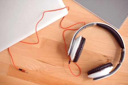 table surface: For music lovers. Top view of headphones lying on the surface of table Stock Photo