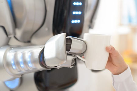 involved: Close up of cup of coffee in hands of robot holding it and giving to a nice girl