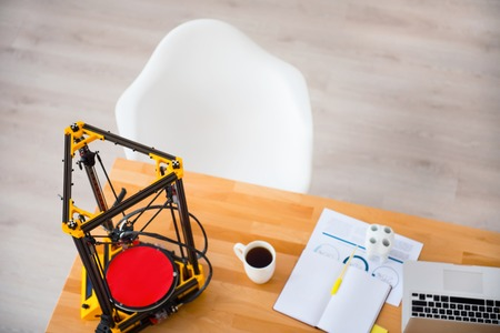 3d printer: Modern workplace.  3d  printer standing on the table