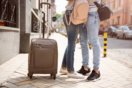 people travelling: Togetherness. Cropped picture of two young people travelling together and arming each other being in a big city