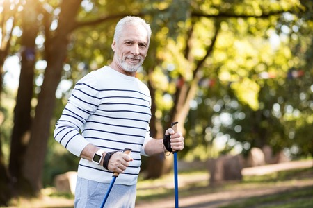 elder tree: Every morning is happy. Smiley man looking at camera while exercising during summer day