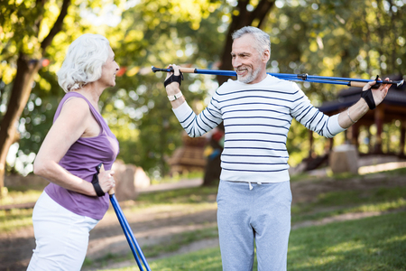 likable: Whole life together. Likable aged couple looking happy together while working-out