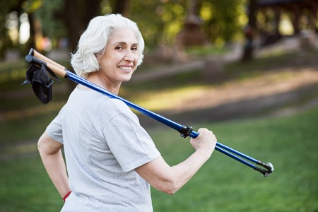 no limits: No limits. Fit and smiley grey elder lady posing while doing sports