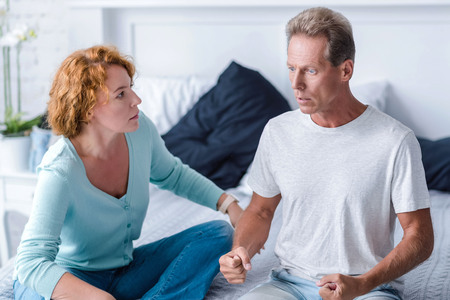 choleric: I hitting you now. Furious husband going to hit his wife while sitting on the bed and arguing
