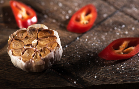 Close up of garlic and pepper lying on a table Stock Photo
