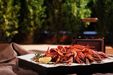 Tasty crayfishes with lemon standing on a table in restaurant Stock Photo