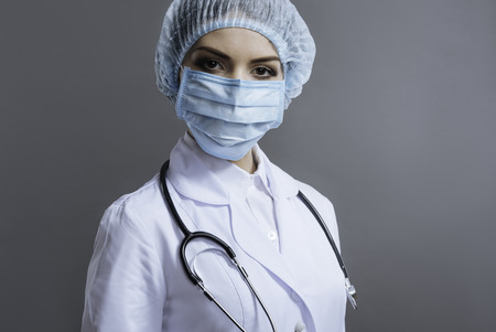 Serious woman working as a doctor