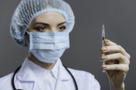 Female doctor preparing to make the injection