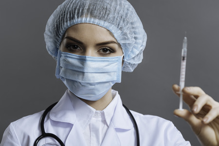 Beautiful doctor preparing to make the injection Stock Photo