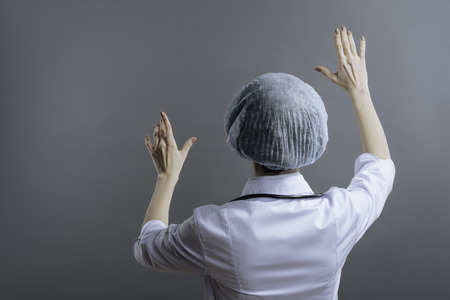 Female doctor standing with her face turned to the wall Stock Photo