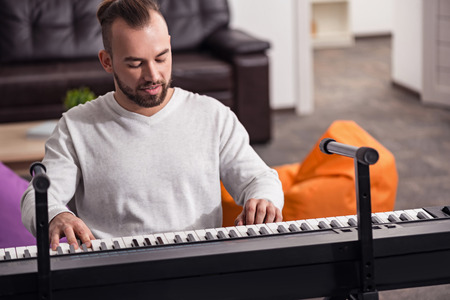 Dedicated handicapped man playing piano Stock Photo