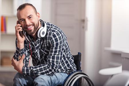 Happy handicapped guy having a pleasant conversation