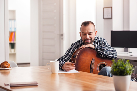 capturing: Enthusiastic young musician capturing his new song