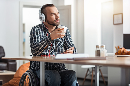 handicapped person: Dreamy handicapped person having lunch Stock Photo