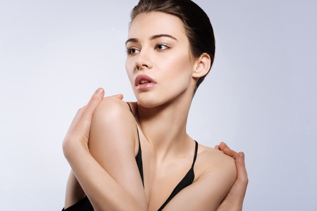 Stunning young model crossing her hands