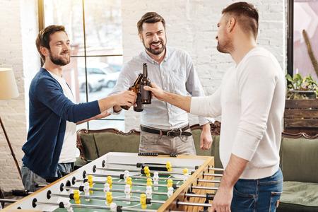 manhood: Positive male friends drinking beer
