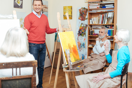 the elderly tutor: Ambitious artist lecturing in painting school.