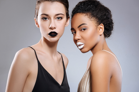 Women of different ethnicities representing opposites Stock Photo