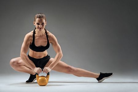 Strong woman holding gym weight Stock Photo