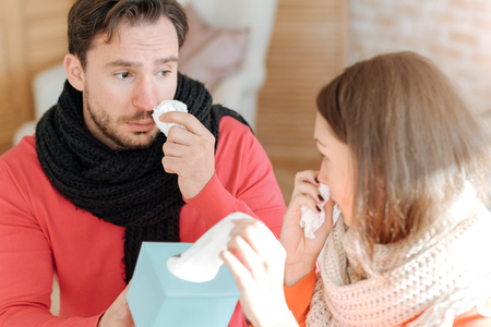 hanky: Young couple suffering from flu at home